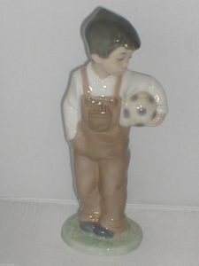 BOY HOLDING FOOTBALL NAO by LlADRO Figurine